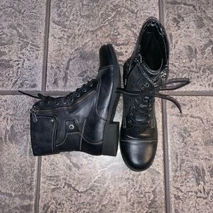 Black combat boots with zippers.